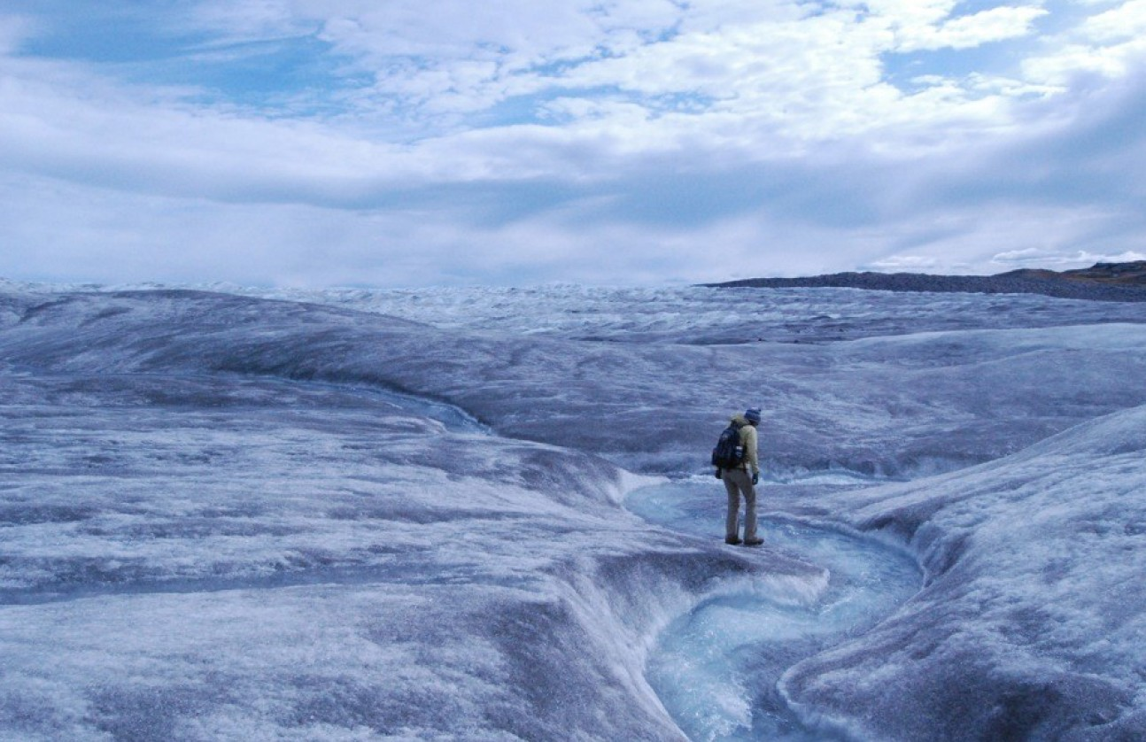 An illustration of a melting ice cap with a person walking on it