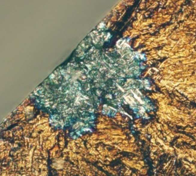 Light micrograph demonstrating the 'blue spot' at the fatigue crack origin