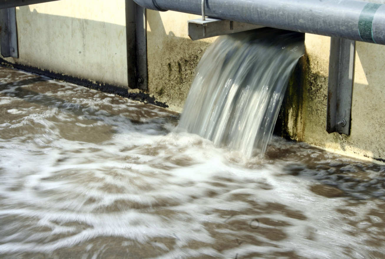 Water flowing at a waste water treatment facility.