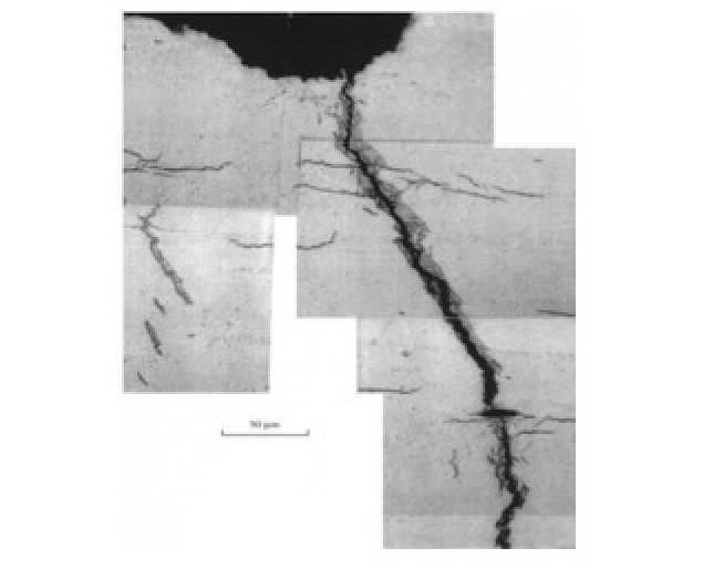 Figure 1: A crack that has propagated through zirconium fuel cladding, surrounded by hydride. Reproduced from [6]