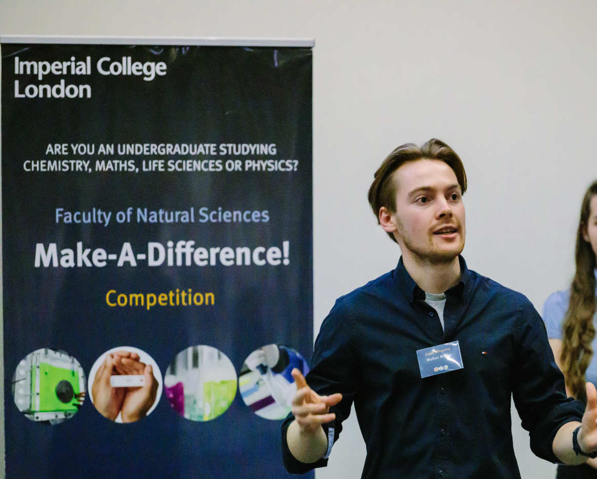 student pitching meaty minds idea to panel