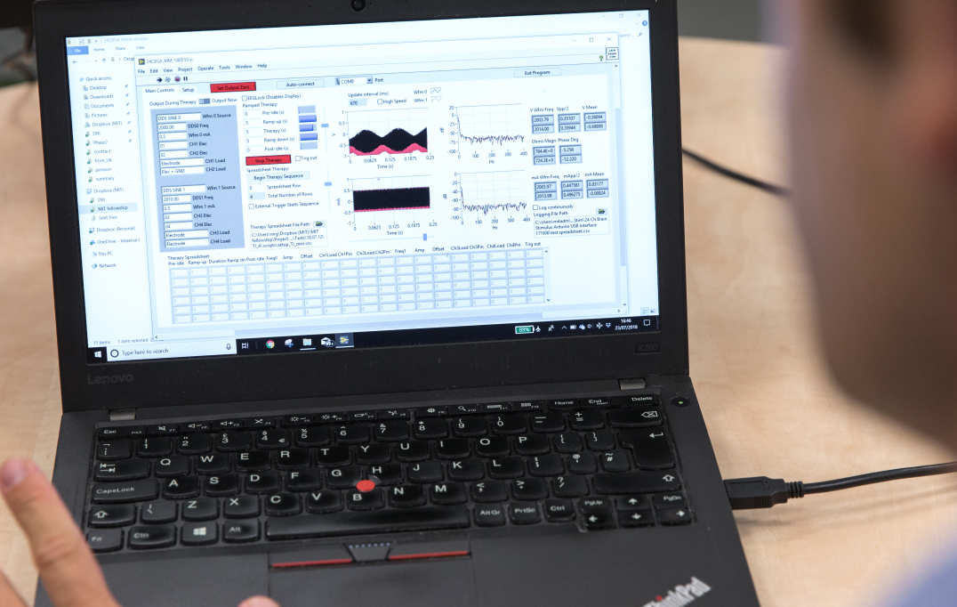 The system's interface on a laptop screen