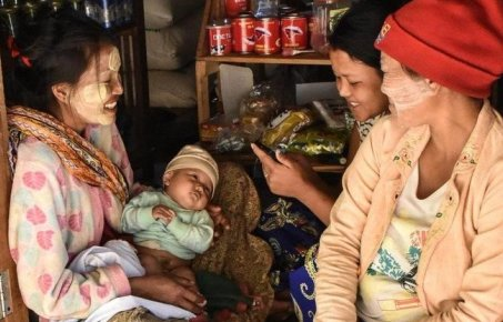 Group of women with baby in rural Myanmar