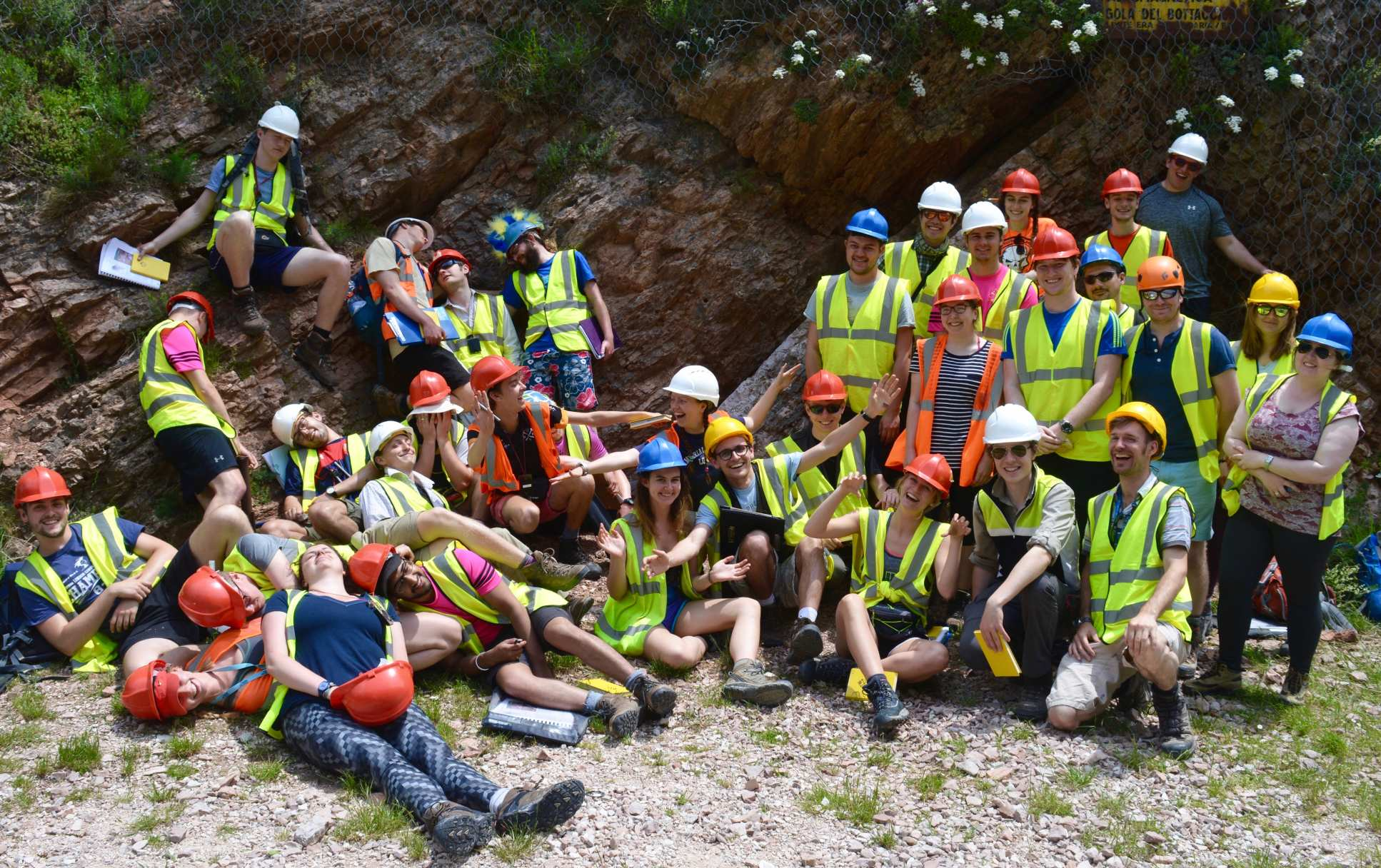 Fourth year students in the Appenines pose for a group photo in their fluorescent vests and hard hats.