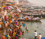 crowds of people on the banks of the ganges