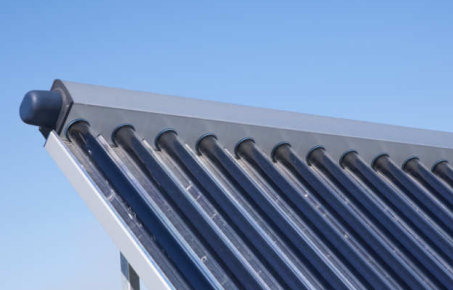corner of solar thermal units against a blue sky