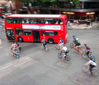 Aerial view of a bus and lots of cyclists