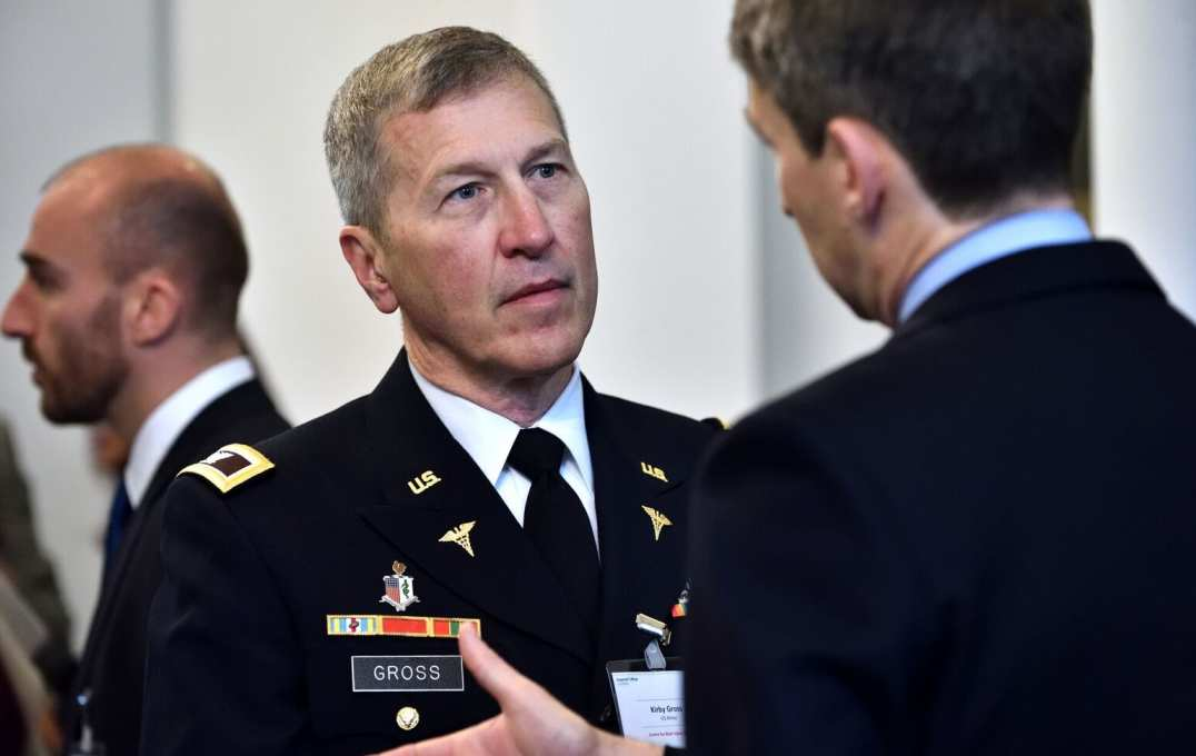 Guests like US Army surgeon Kirby Gross mingled and networked during the conference