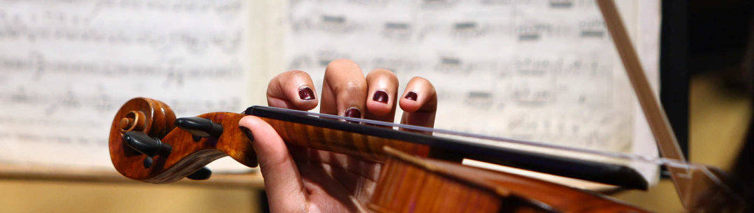 Close up of a person playing a violin