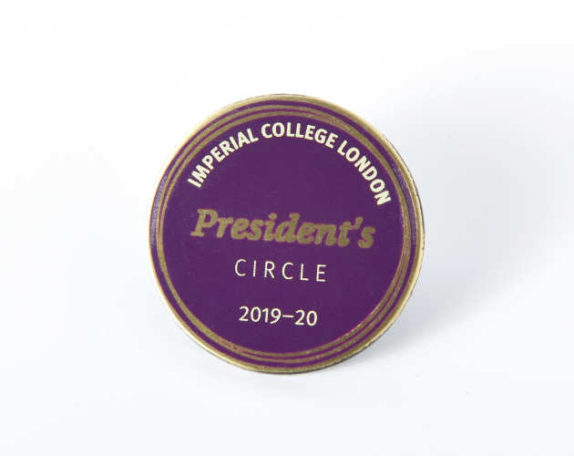 A purple President's Circle badge