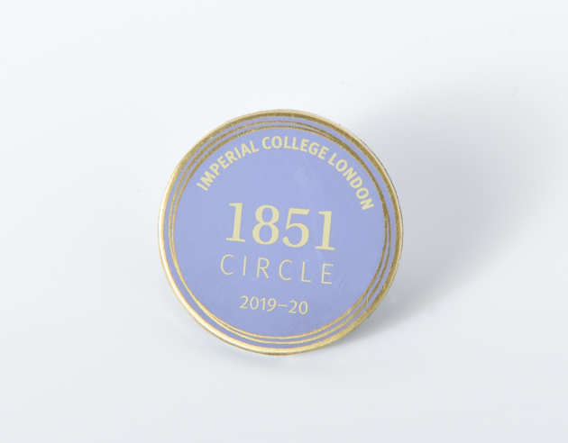 A pale blue 1851 Circle badge
