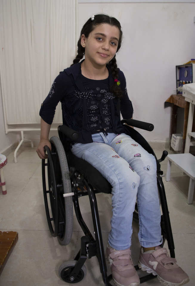 Photo of young girl in wheelchair