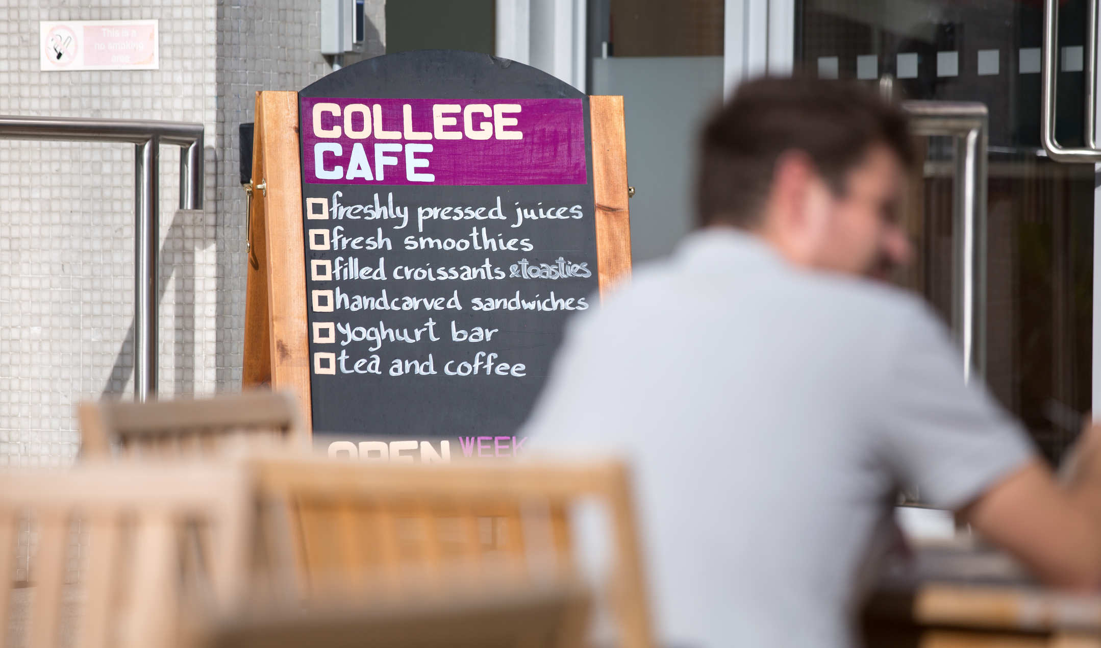 Picture of a sign outside the College Cafe