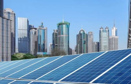 Solar panels and city skyline