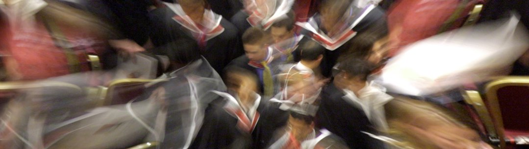 Blurred image of scholars in motion