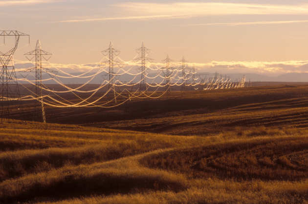 Electric power lines across fields