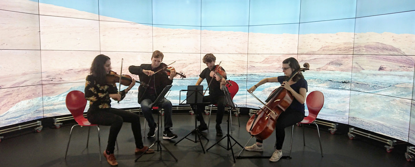 The Ligeti Quartet practises at Imperial's Data Observatory in front of a Curiosity photo of Mars