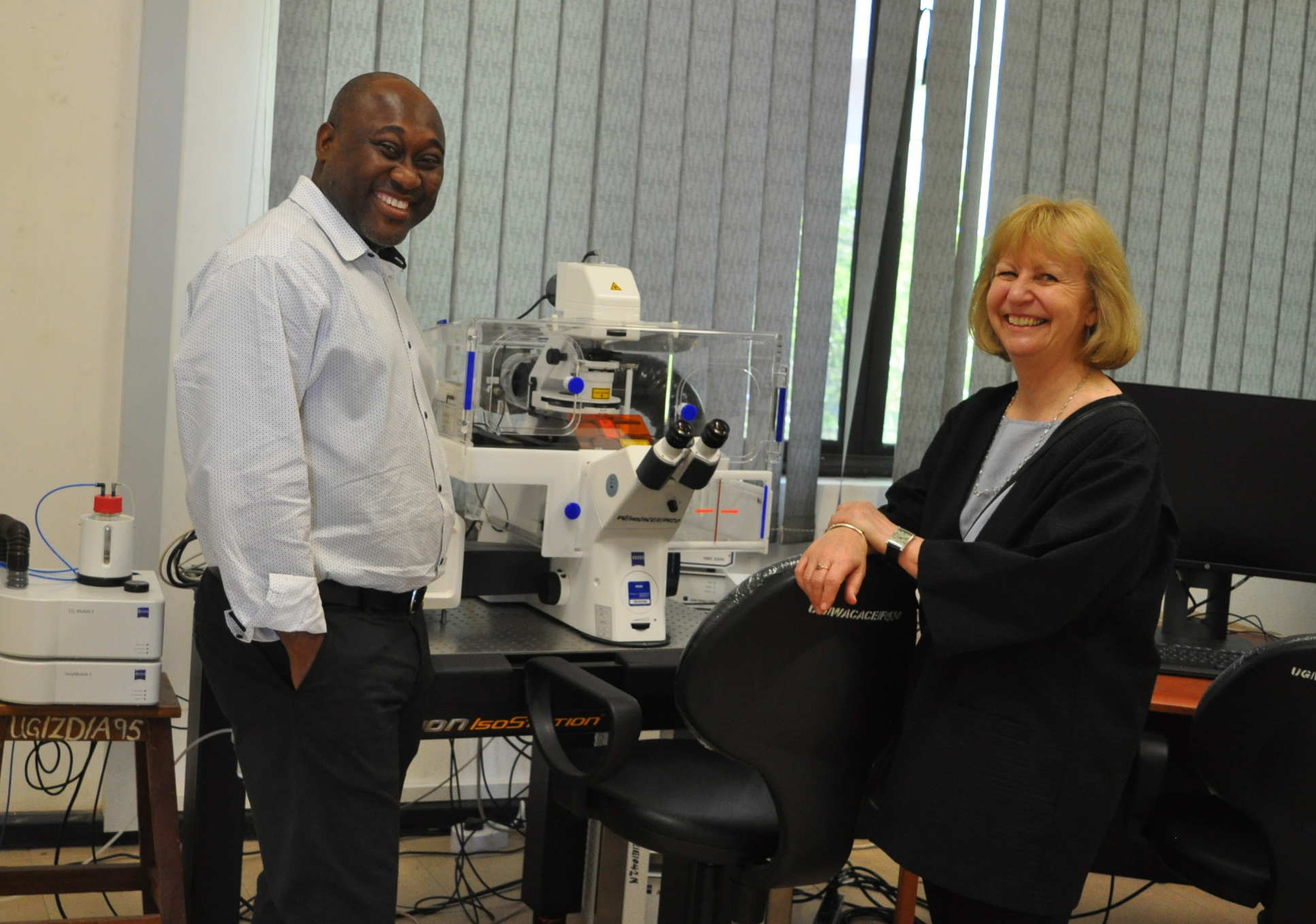 Professor Dallman discussed lab equipment with the Director of the West African Centre for Cell Biology of Infectious Pathogens at the University of Ghana