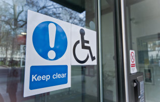 photo of wheelchair sticker on door