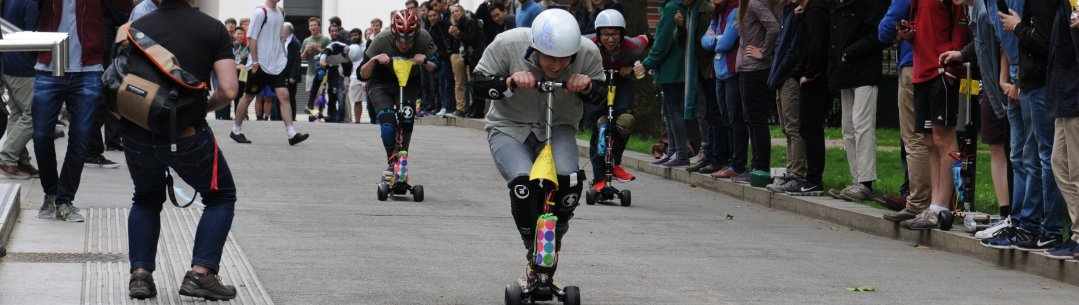 Students at the start line for electric scooter race