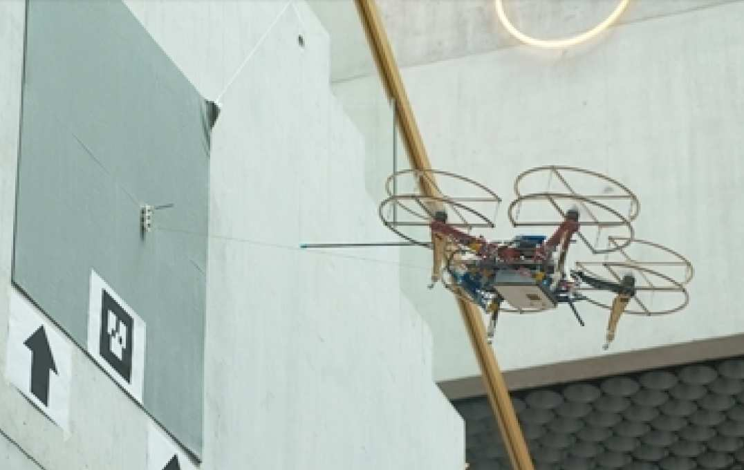 Photo of drone docking onto a wall