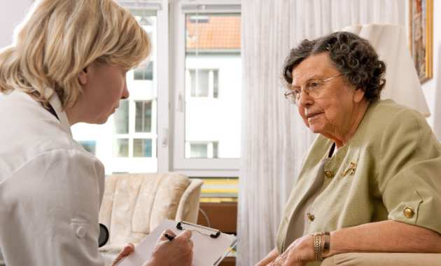 GP talking to elderly patient