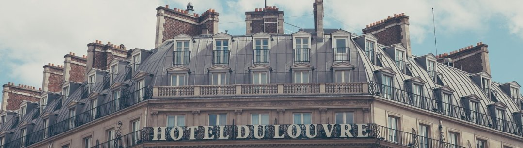 Photograph of a building with French flag