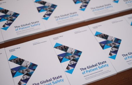 Photographs of stacks of the global state of patient safety report