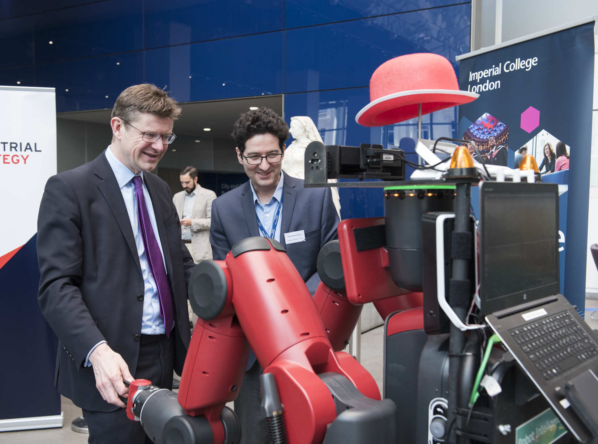 BEIS Secretary Greg Clark dances with ROBOT DE NIRO at the AI Sector Deal launch hosted by Imperial in April