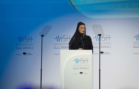A photograph of a female speaker at the WISH conference
