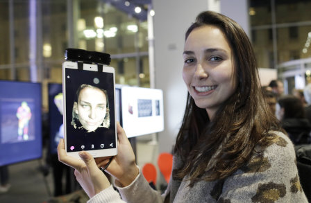 Girl holding ipad with 3D rendered image of own face