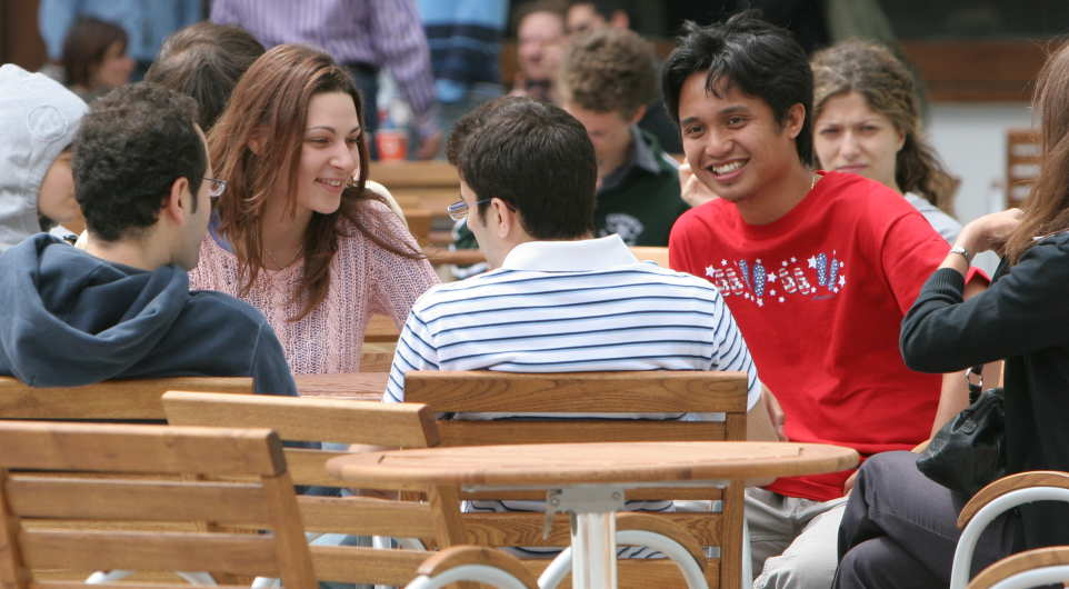 a cohort of students socializing on campus