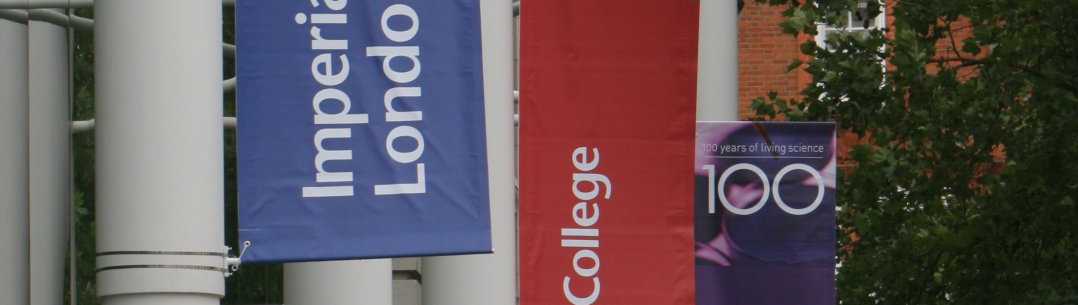 Imperial College London banners hang from the side of a building.  The banners say '100 years of living science'.