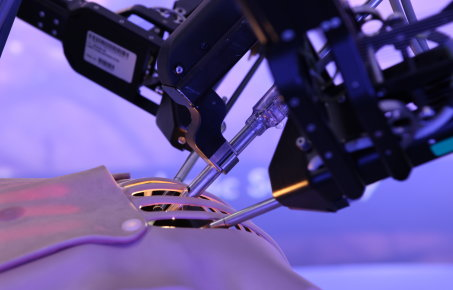 A surgical robot working on a model