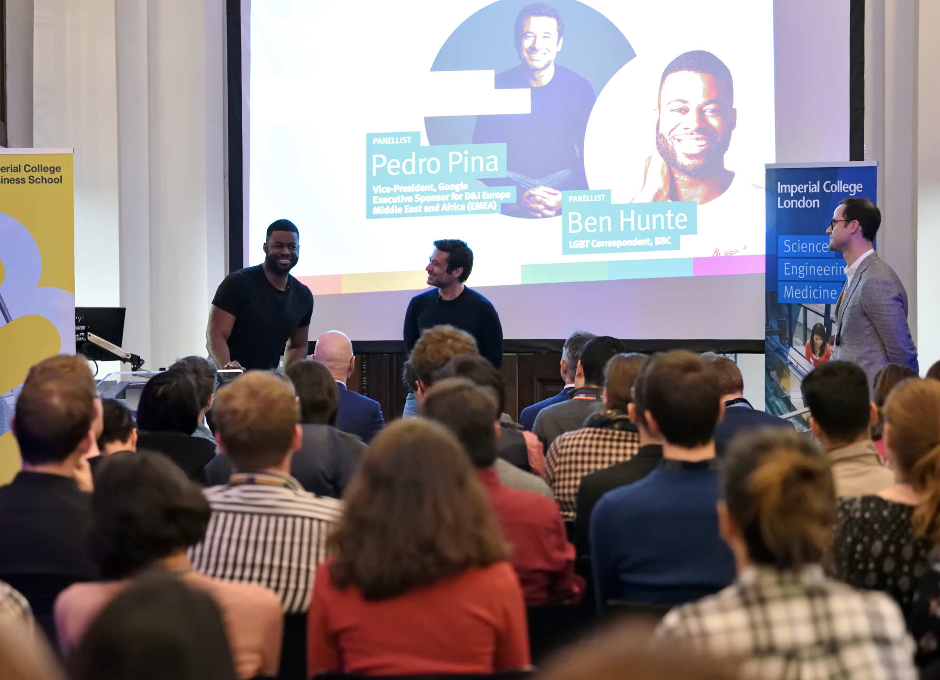 Guest Speakers Ben Hunte and Pedro Pina talking in front of an audience