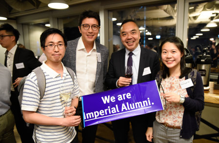 Alumni posing for a photo at an event in Hong Kong