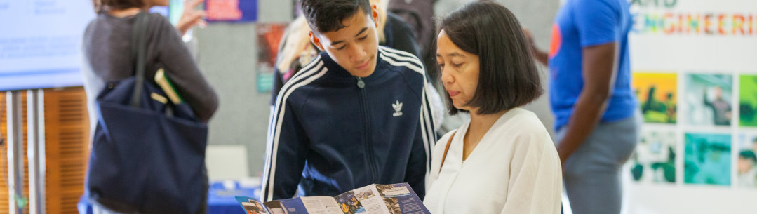 Parent and child looking at prospectus