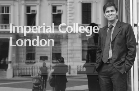 Neeraj standing in front of Imperial College London sign