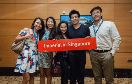 Three girls and two boys at an alumni event in Singapore