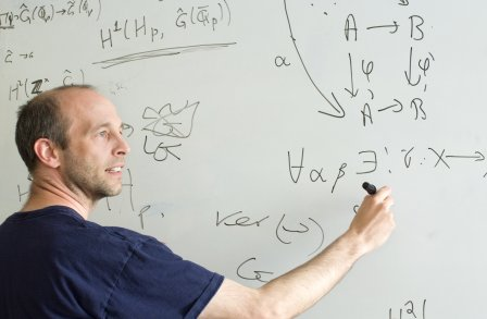 Prof Kevin Buzzard (from the Number Theory group) working out equations on a whiteboard