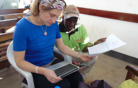 Dr Katharina Hauck (reader in health economics at Imperial College) working with her colleague on HIV transmission research in Zambia.