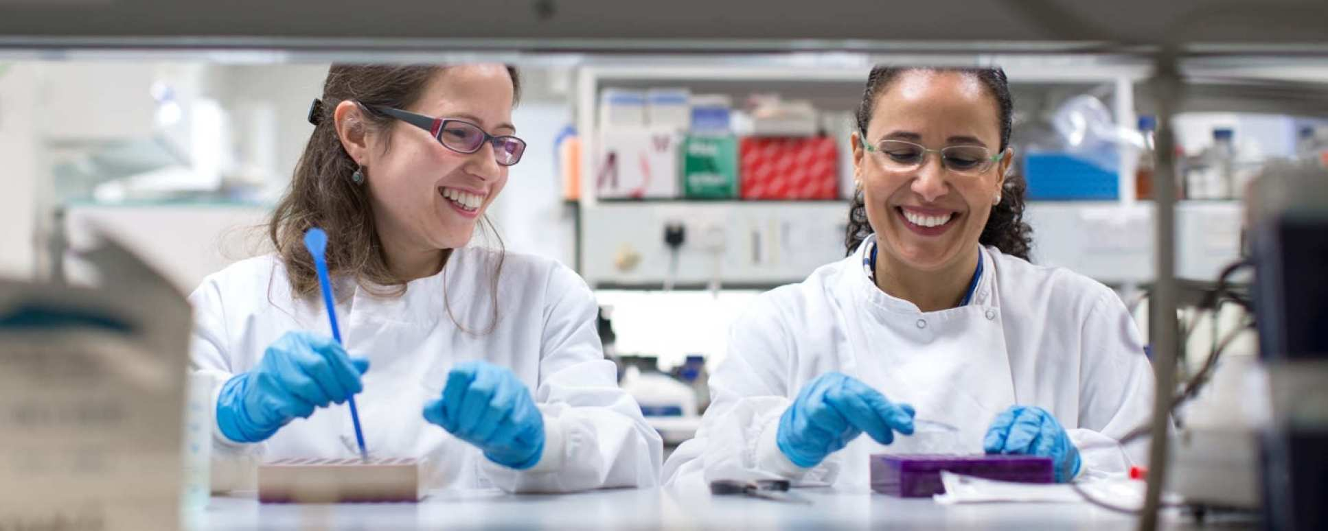 Photo of two female lab staff