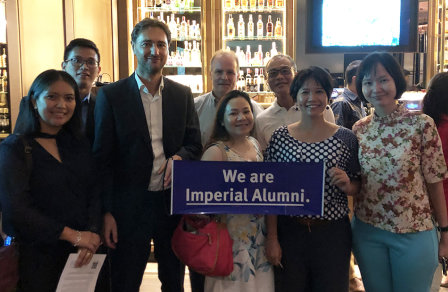 Alumni posing for a photo at an event in Malaysia