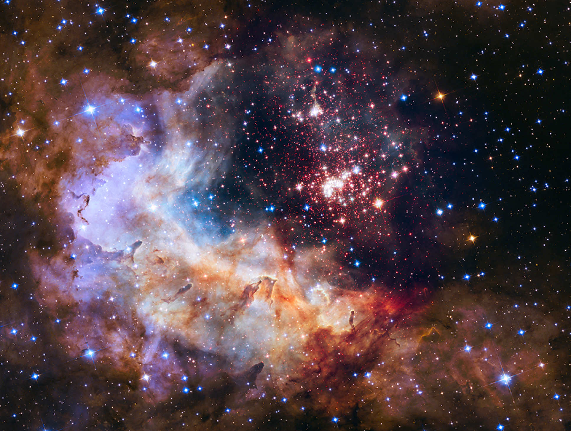 An image captured by the Hubble of Westerlund 2 - a giant a giant cluster of about 3,000 stars located 20,000 light-years away in the constellation Carina.