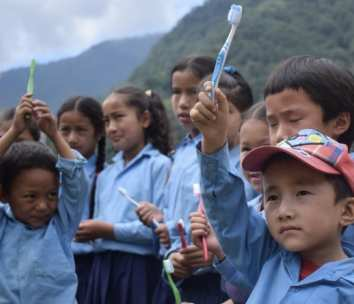 Children in Nepal holding toothbrushes