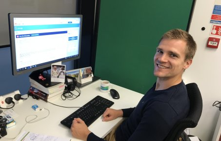 Oliver Schmidt sitting at his desk about to take part in the AMA