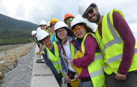 Msc.students happy to encounter a dam