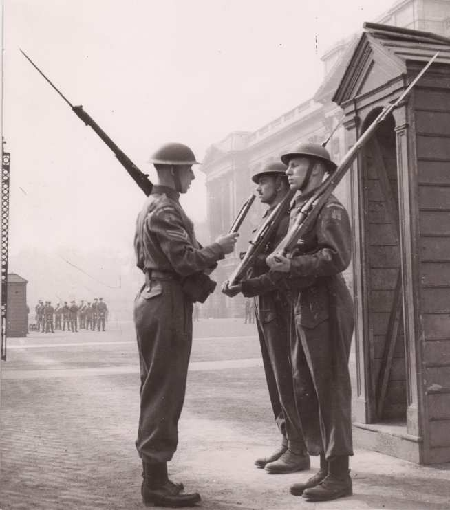 Undergraduate students guarding Buckingham Palace
