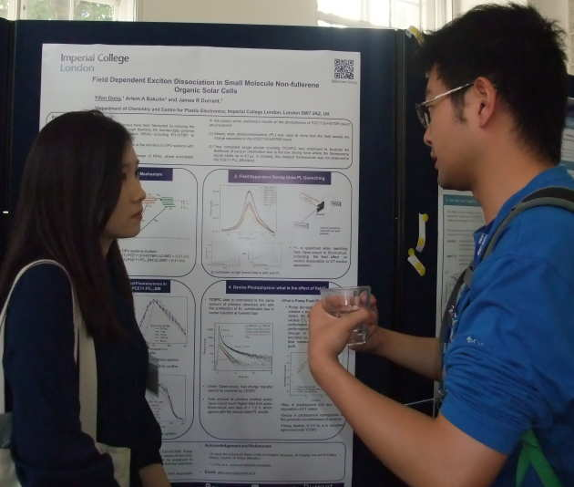 Male and female student discuss scientific poster
