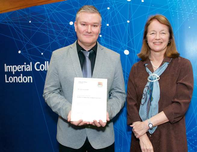 Jon Jaundrill receives President's Award from Alice Gast